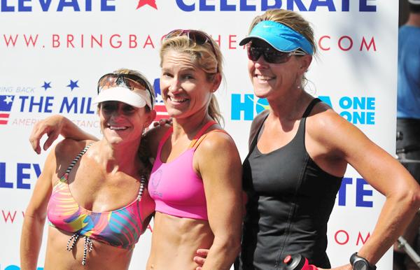 The top three Masters Elite Women, led by winner Desa Mandarino, middle.