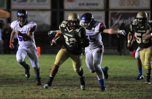 San Marcos' Nathan Coffey catches Santa Barbara running back Junior Garcia from behind.