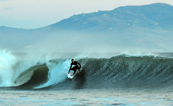 Kilian Garland, pictured, paddled out with Demi Boelsterli and Peterson in a professional expression session.