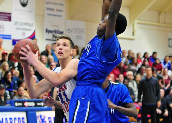 Scott Everman looks to score while being pressured by a Diamond Ranch defender. Everman led the Royals with 11 points.