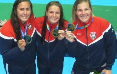 Craig, Hill, Neushul, Team USA glowing in gold
