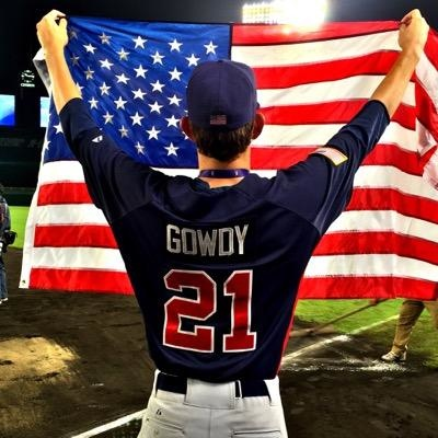Santa Barbara High's Kevin Gowdy holds up flag during post-game celebration after Team USA defeated host Japan in the WBSC U18 World Cup final.