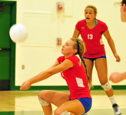 Emily Allen, foreground, who is now at UC Davis, with sister Chloe Allen (13) on the court together last year.
