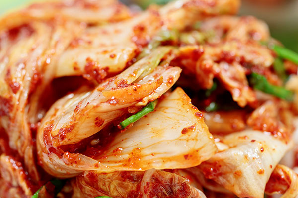 Kimchi, a Korean dish made from cabbage, is an example of fermented foods.