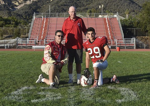 Tim Jimenez Sr., left, with son Timothy Jimenez Jr., right, and legendary Carpinteria football coach Lou Pannizon.