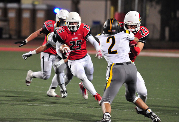 John Harris gets a block from teammate Dylan Streett on Newbury Park's Tavis Valenzuela on a long running play.