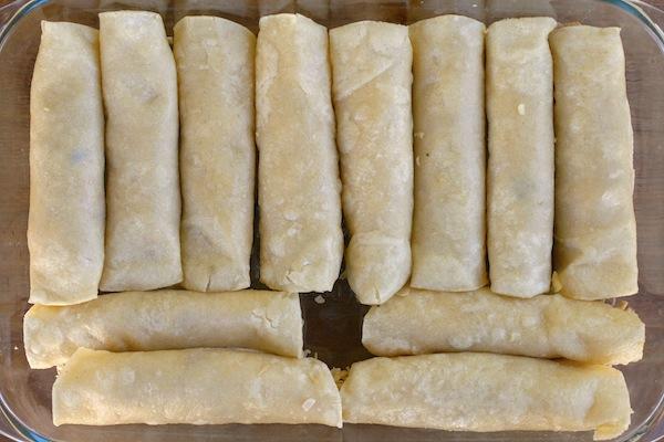 rolled enchiladas in casserole dish