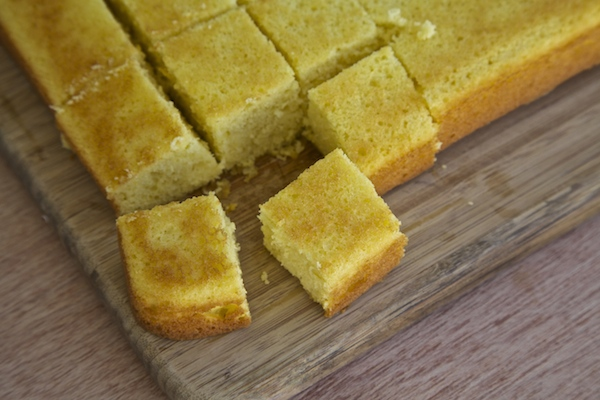Lemon cake cut into cubes for trifle bowl.