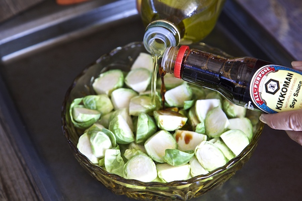 coating brussels sprouts with olive oil and #kikkomansabor