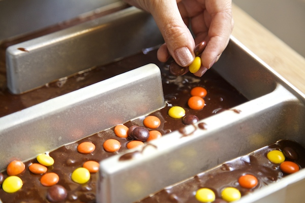Top brownie batter with Reese's Pieces before baking.