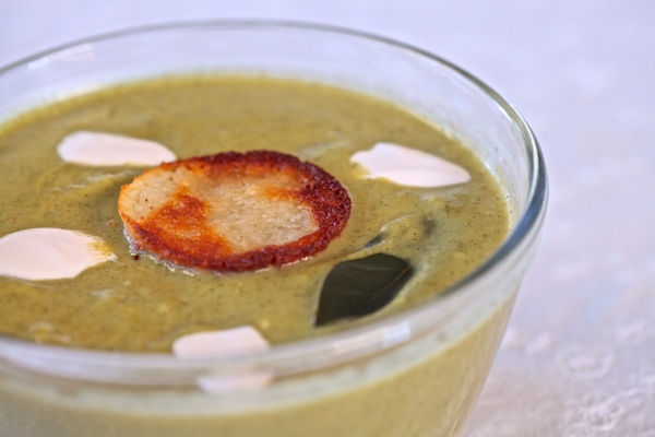 zucchini soup served with a cotija cheese crisp