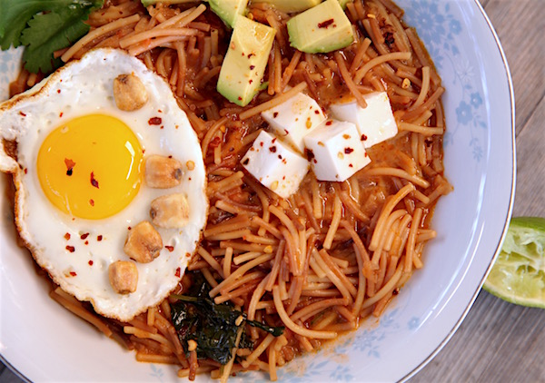 This fideo is made with Barilla's cut spaghetti and cooked in a spicy broth. Garnish with panela cheese, avocado, fried egg, corn nuts, cilantro and fresh lime juice. Spicy fideo fully loaded you'll never want it any other way.