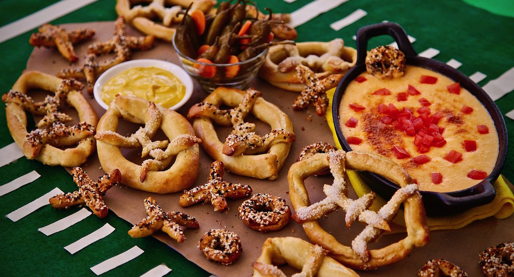Football shaped pretzels served with a Mexican Beer Oaxaca Cheese Dip. Absolutely delicious combination of my american culture and my ever present Mexican culture.
