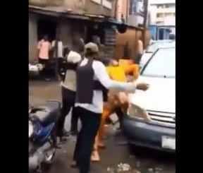 SARS Operatives Beating Man Like A Thief In Lagos (Video)