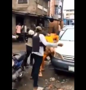 SARS Operatives Beating Man Like A Thief In Lagos (Video)