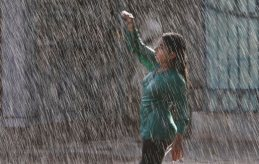 An Indian girl dances in artificial rain at Jalavihar water park on a hot summer day in Hyderabad, India, Tuesday, May 19, 2015. Heat wave continued in many parts of northern Indian even as capital Delhi witnessed season's first severe storm on Tuesday bringing temporary relief from the heat, according to local reports. (AP Photo/Mahesh Kumar A.)