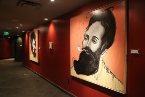 iPic theaters an affordable luxury chain crafted by former Muvico owner is lined with art.