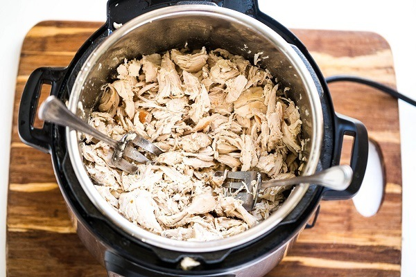 Shredded chicken in a pressure cooker.