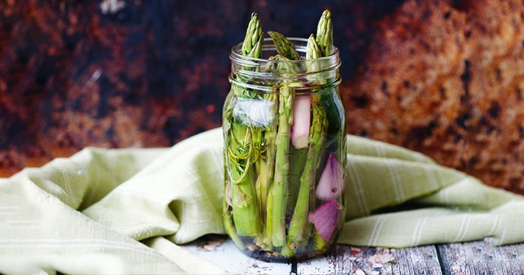 Asparagus with shallot ready to pickle in mason jar