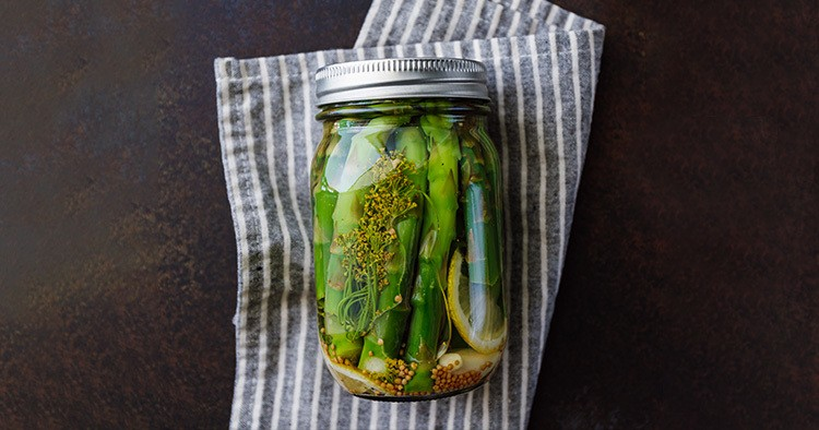 Top view of pickled asparagus in a jar