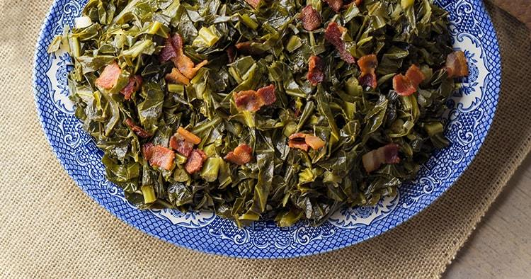 Top view of a serving plate filled with Southern style collard greens.