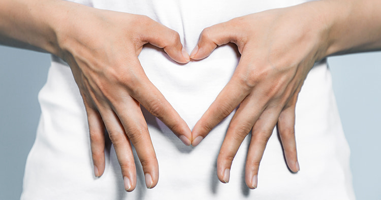 young-woman-who-makes-heart-shape on the gut