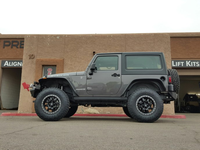 2015 JEEP 2-DR RUBICON 4X4 WITH A 2.5 ROUGH COUNTRY LIFT KIT AND FUEL TROPHY WHEELS 18X9 BLK AND GREY RING WITH TOYO OPEN COUNTRY ATII 28575R18 AND BUSHWACKER FLAT FENDER FLARES (2)