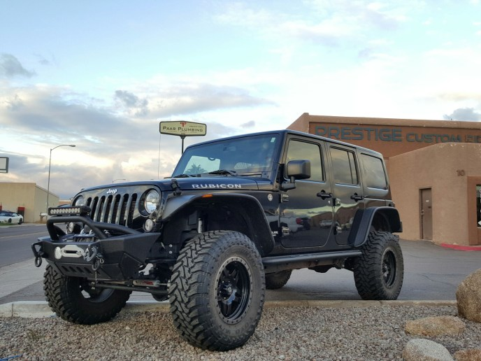 2015 JEEP JK UNLIMITED RUBICON WITH A 4 ROUGH COUNTRY LIFT KIT AND SMITTY BUILT FRT AND REAR BUMPER LIFGHT BAR SMITY BUILT WINCH WITH FUEL WHEELS AND TOYO MTS SMITTY BUILT ROCKER GUARDS (7)