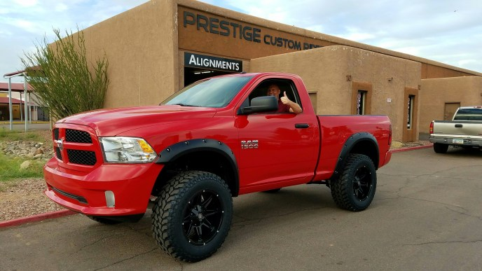 2016 RAM 1500 2WD WITH A 7 CST SUSPENSION LIFT KIT AND A SET OF MAYHEM RAMPAGE 20X10 BLACK AND THE NEW FIRESTONE DESTINATION MTS 35X12.50R20 WITH BUSHWACKER POCKET STYLE FENDER FLARES (2)