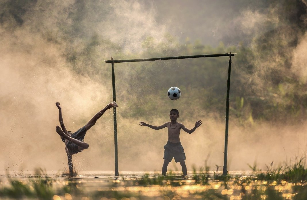 (Young) children being creative whilst playing football, as a fitting reference to the theme of the talk - namely how children represent life, and life is about creativity.