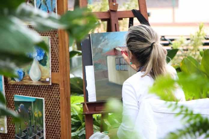 Women painting in garden