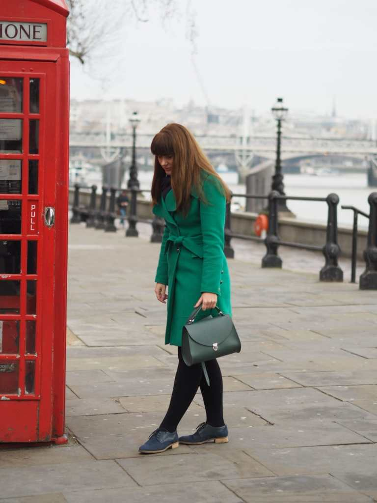 Picture of me standing in front of a red english telephone box.  Six Things I Wish I Knew When I Moved To London.
