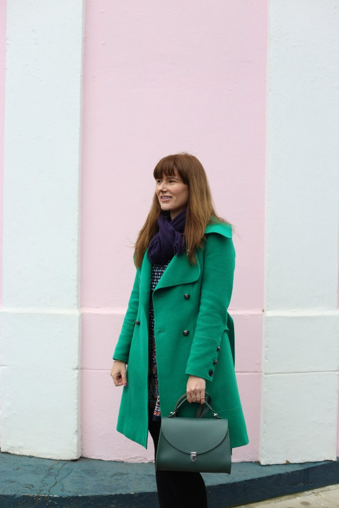 Pretentious Fringe wearing her emerald green coat
