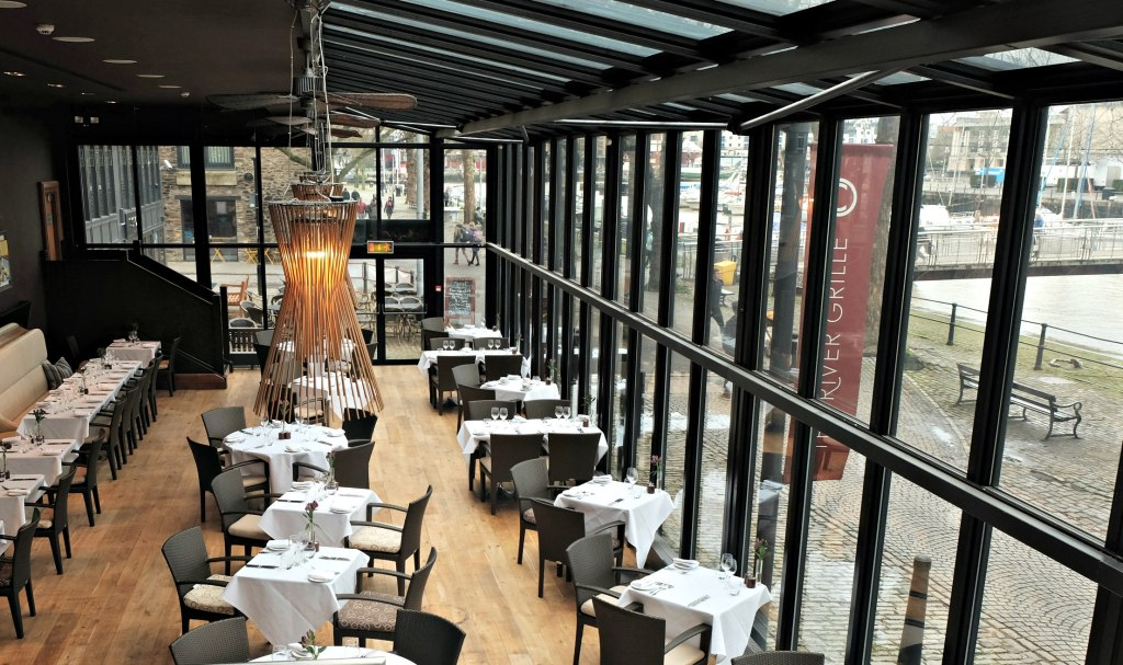 Picture of the The River Grille showing off the large glass windows looking out to the harbour.