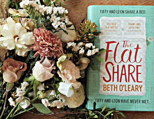 Picture of The Flatshare by Beth O'Leary Book next to gorgous bunch of flowers.
