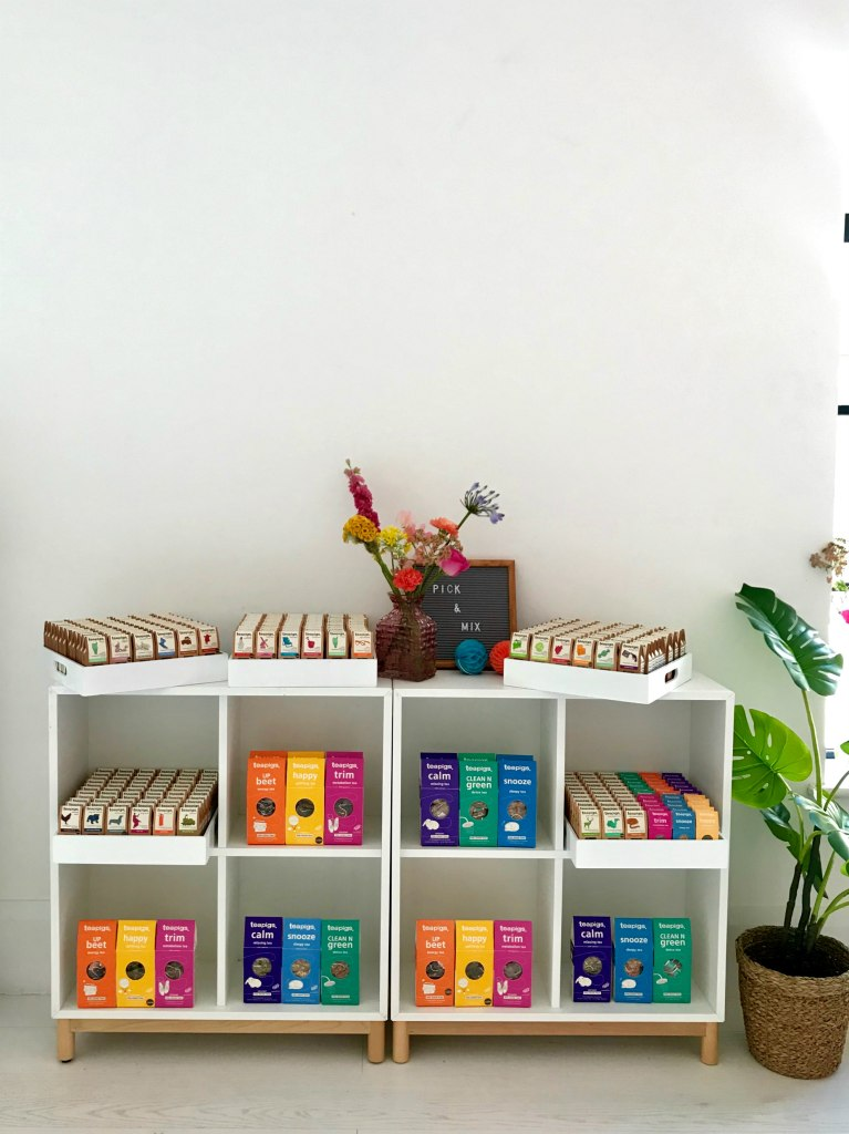 Picture of bookshelf with lots of different teas all over it.  Teapigs Tea School Day.