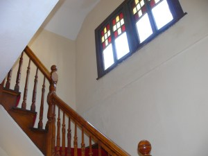 Stairway With Stained Glass Windows in Schenectady NY