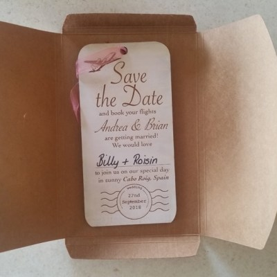 Wedding invite on wood with envelope