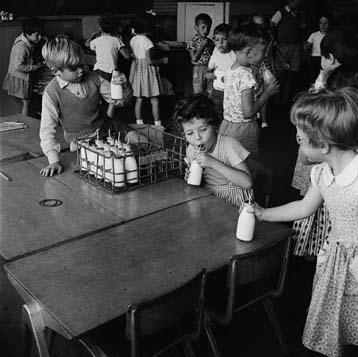 Mini milk bottles history