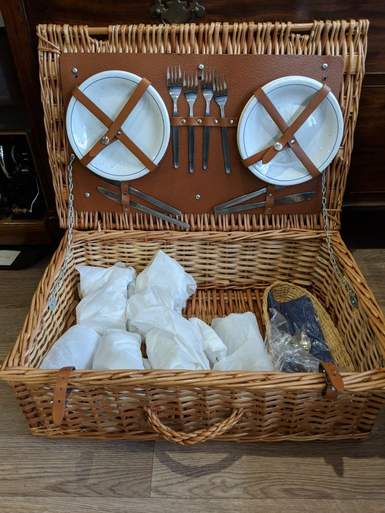 Wicker picnic basket with settings for four people