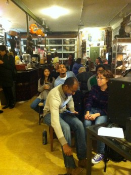 The crowd at Biddle's Escape for a Pretty Owl Poetry Spotlight Series in Pittsburgh, PA.