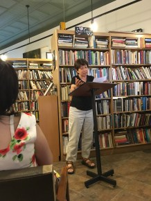 Joan Bauer, Issue 7 contributor, reads her poetry to a crowded audience at EEBX