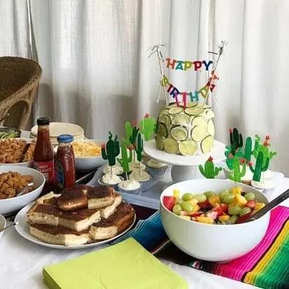 Taco Twosday birthday party spread! Homemade sopapilla, semi-homemade strawberry limeade cake, and fruit salad for a festive cinco de mayo birthday party