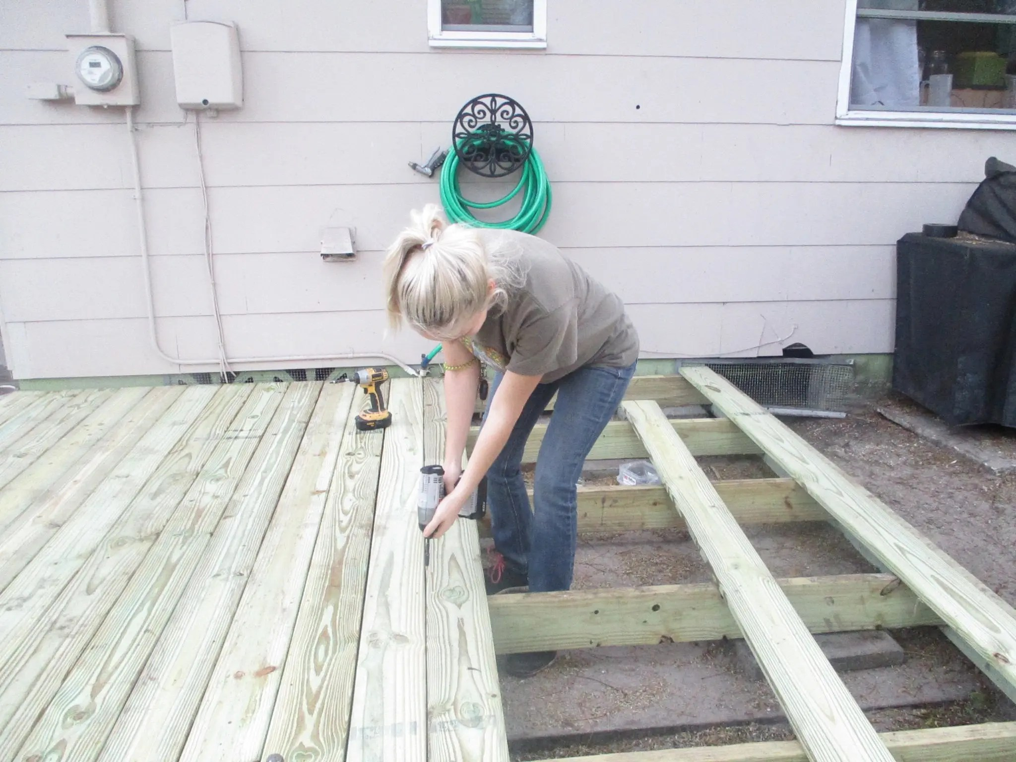 screwing down the deck boards on my DIY floating deck