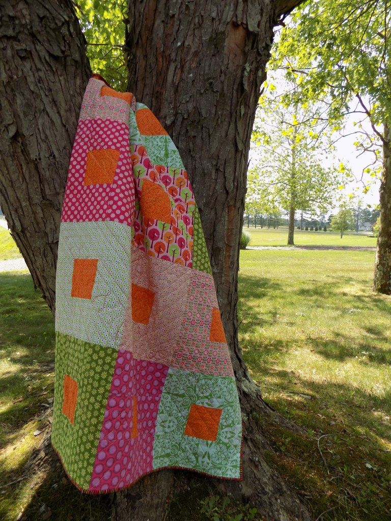 simple square-in-a-square throw quilt in orange, pink, and green