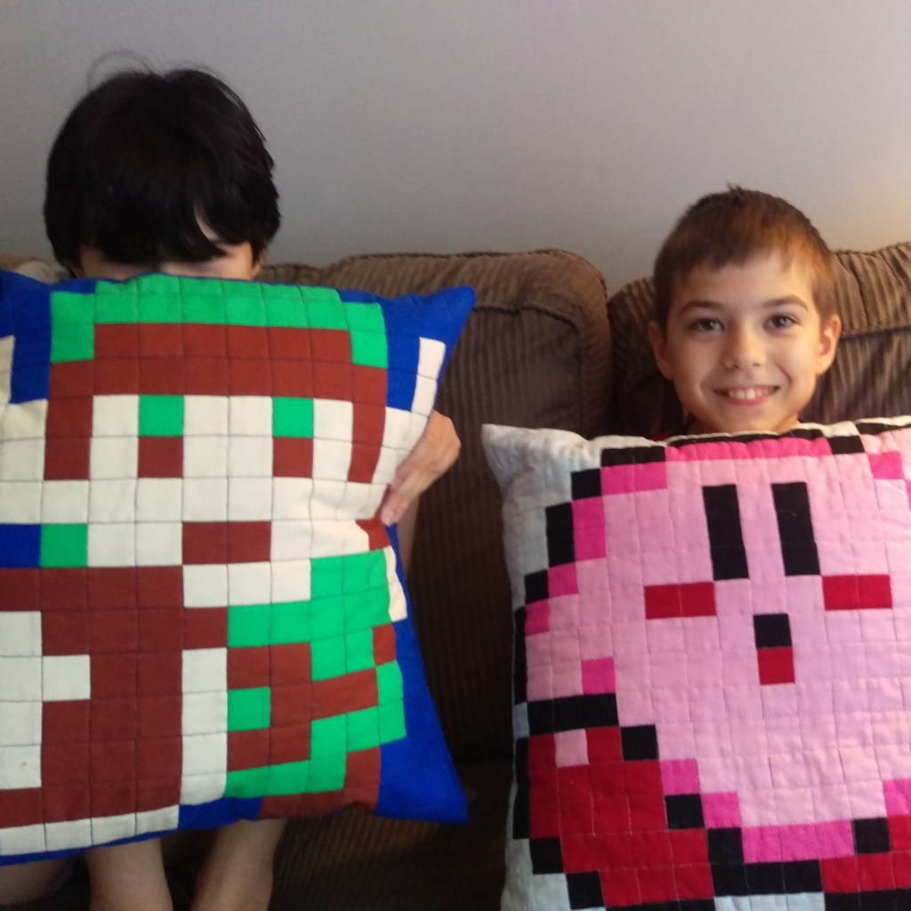 quilted pillows featuring 8-bit video game characters Link and Kirby