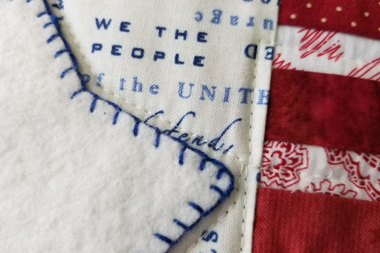 detail of flag mug rug