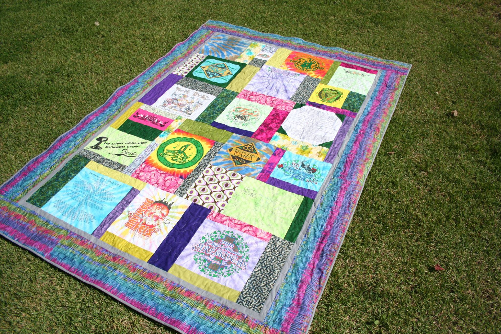 T-shirt quilt featuring Irish dance shirts with lots of pink, purple, and blue