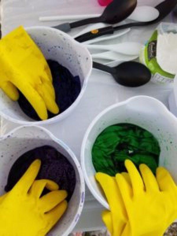 bins of fabric soaking in dye