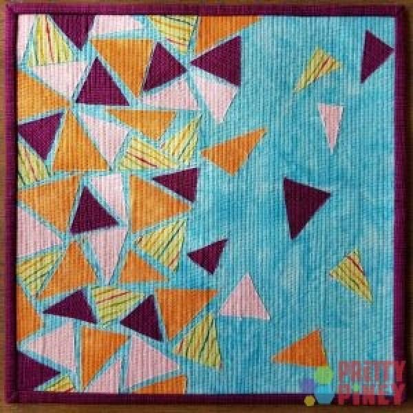 """Flight"" triangles mini quilt"